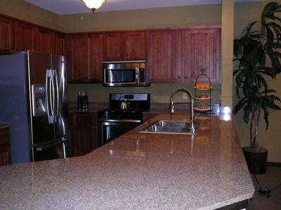 Large kitchen with New Appliances and a Granite Counter Top