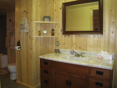 Lower level - large full bath with tiled shower. Full size laundry room, also.