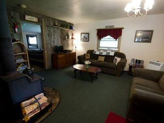 Missoula cabin photo - Living room and wood stove, bedroom off to left
