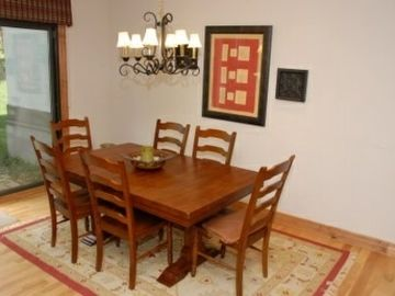 The dining room table can accomodate 8 people. (Two additional chairs are not shown in the photo). So, you can enjoy large family dinners.