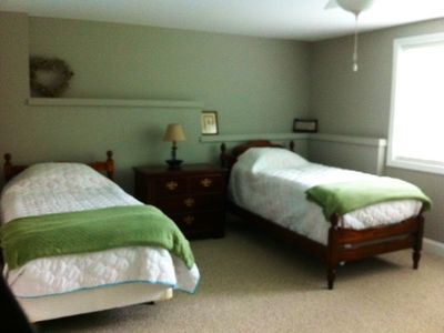 Two twin beds located on the ground level with views of the lake!