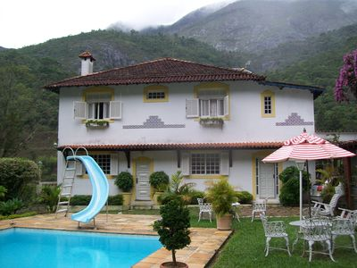 Ranch with 5 bedrooms and 3 suites, balcony, pool with slide and waterfall