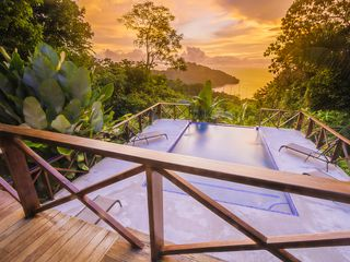 Manuel Antonio house photo - Surreal - but the colors coming from the sunsets can be so many colors!