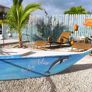 Relax in a tropical backyard. Bright and fun decorations. Great family photos!