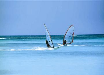 World renowned kite surfing and wind surfing thanks to Aruba's famous breezes