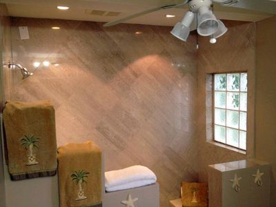 Lower Bathroom with large walk in shower and bench seat