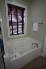 Folly Beach townhome photo - Master bathroom spacious spa tub