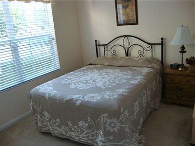 Downstairs bedroom with queen size bed and full bath with walk-in shower stall.