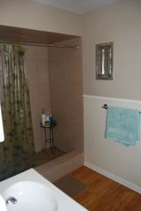 Rockport house photo - Large open shower, plenty of storage, conveniently joins bedroom