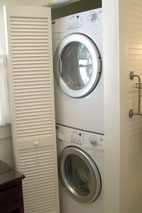 Full size washer dryer within family shower room.