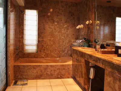 Malibu house rental - The Master Bathroom with the steam room and shower that overlooks the beach.
