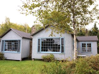 Baddeck house photo - Lakeside Boat Cottage gives wonderful Water Views from Den and Bedroom windows.