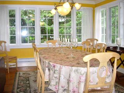 Dining Room Surronded in Windows and Seating for 10 Adults+
