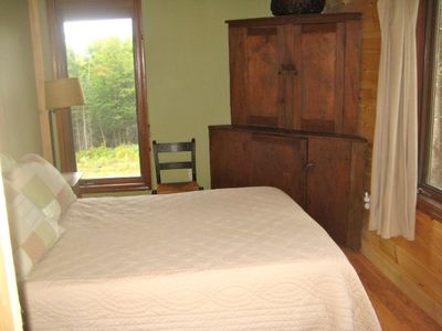 Westmore cabin rental - Double bedroom and antique corner cupboard.