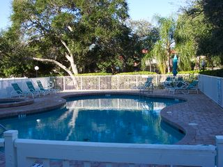 Cape Canaveral condo photo - Swim and soak in the heated pool and jacuzzi