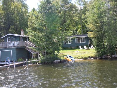 view of boat house, boat lift and cabin area. enjoy cocktails on boat house deck