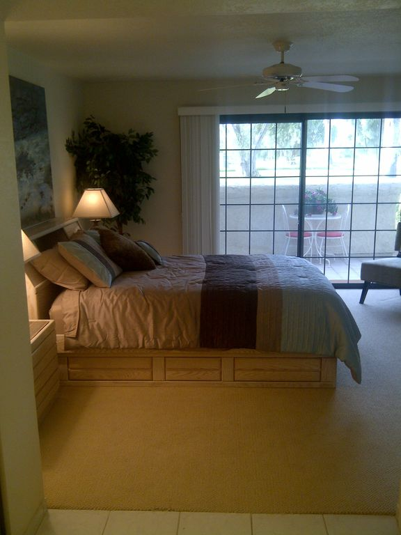 Master Bedroom with private patio overlooking mountains and golf course