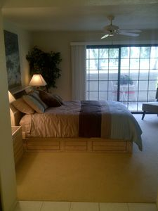 Palm Springs condo rental - Master Bedroom with private patio overlooking mountains and golf course