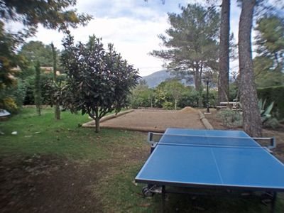 Boule court and ping pong ball facing mountains