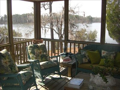 Relaxing screened-in porch provides perfect setting for special visits and rest.