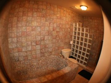 Huge Custom tile bathtub and Shower in Bathroom 3 located downstairs.