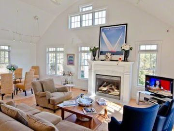 Second Floor Great Room Has Two-And-A-Half Story Vaulted Ceiling With Open Living & Dining Areas