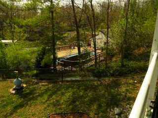 veiw of pool/tiki bar from deck - Osage Beach villa vacation rental photo