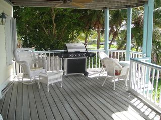 Key Largo house photo - BBQ grill on lower veranda and a great spot for your morning coffee