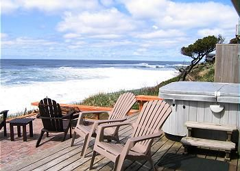 Andante's deck, hot tub and view of the ocean!