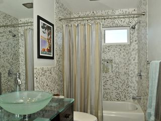 Palm Springs house photo - Remodeled Bathroom With Custom Eco Vanity, Toto, Recycled Glass Tile Throughout