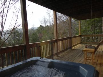 Lower deck, hot tub and swing