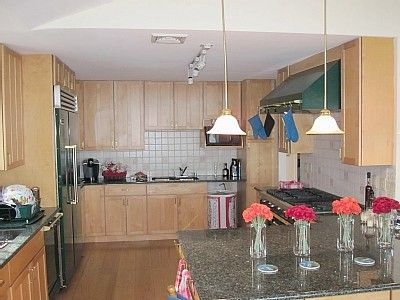 Large Chef's kitchen with Viking appliances, 6 burner hob, and two dishwashers