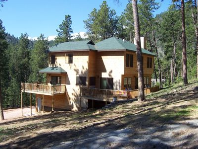 Side view of cabin and fenced property