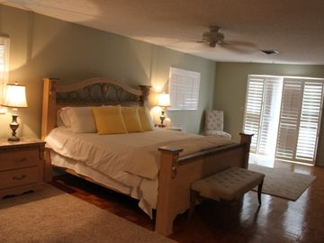 Master Bedroom with sliding door out to 15'x30' deck overlooking the pool area.