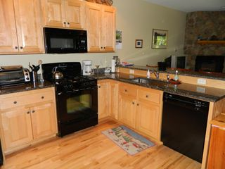 Carrabassett Valley condo photo - Kitchen with beautiful Granite counter tops and gorgeous hardwood floors.