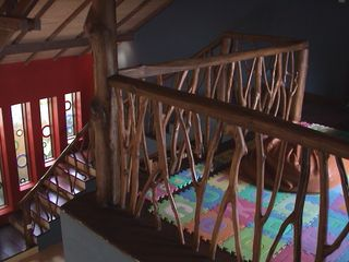 Sanur house photo - View of coffee-branch banister and stained glass windows from TV loft.