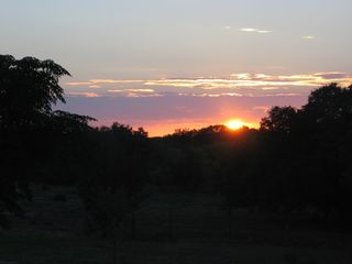 Lampasas house photo - Sunset from the rear deck.