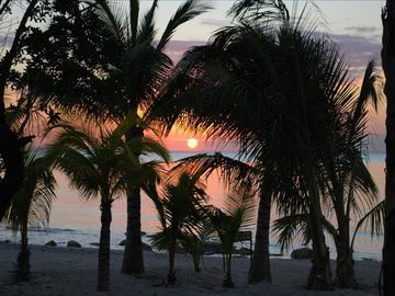 A beautiful Cozumel Sunset from Resdencias Reef beach.