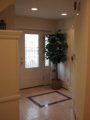 Seaside Heights condo photo - Foyer with shower, closet, washer/dryer and garage access.