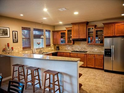 beautiful chefs kitchen, stainless steel appliances and great counter tops