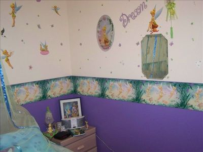 Tinkerbell bedroom complete with ipod docking station tv and ceiling fan