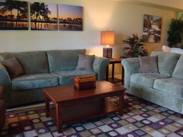 Waikoloa Beach Resort condo rental - Living room has plenty of seating; couch converts to queen bed.
