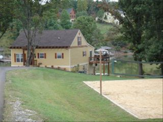 Moneta cottage photo - Front of House w/Beach Volleyball Court