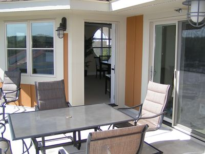 Traverse City condo rental - Private patio with table and chairs