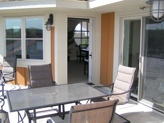Traverse City condo photo - Private patio with table and chairs