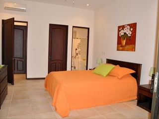 Playa del Coco condo photo - Master bedroom with large walk-in closet and spacious ensuite bathroom