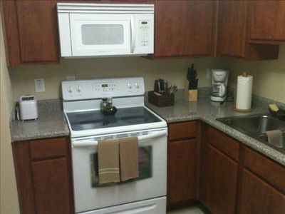 Kitchen with Oven/Stove, Microwave, Refrigerator, and various small appliances