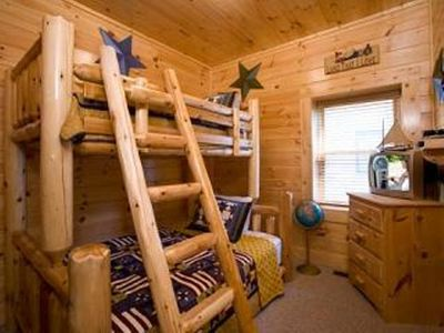 .Children's log bunk bed - single on top, double on bottom. In bottom floor