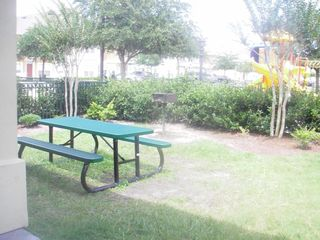 Venetian Bay condo photo - Picnic area by pool