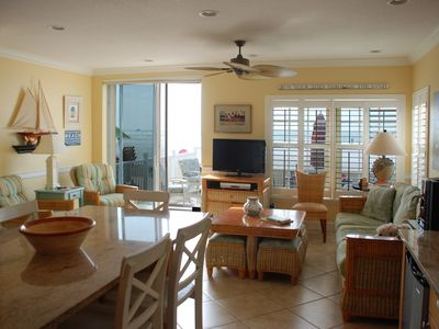 Newly furnished living room overlooking large private beach patio & water views